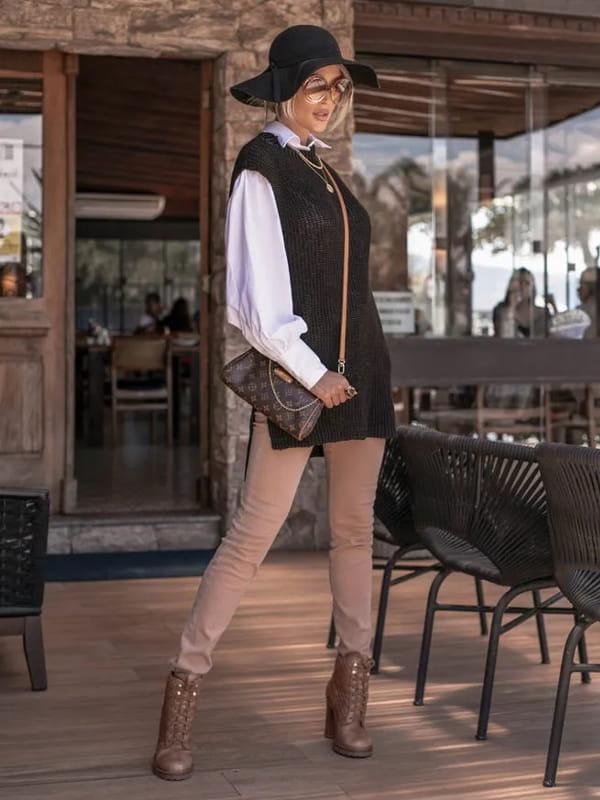 Colete feminino: o aliado dos seus looks: modelo vestindo um colete pied de poule.