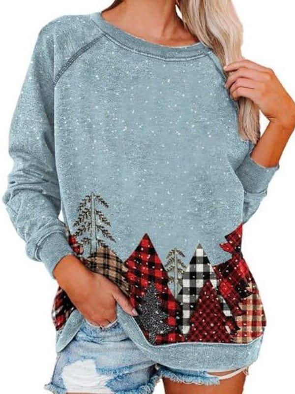 Patchwork: uma tendência sustentável: modelo vestindo uma blusa xadrez trabalhada em patchwork.