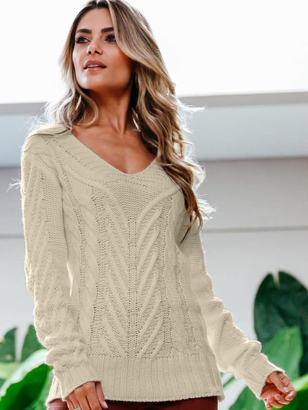 Blusa de frio de tricot: mulher usando uma blusa de tricot com trança.